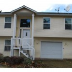 10718 SE Holgate Blvd, bright and yellow home for $170,000
